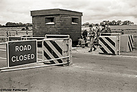 British soldiers who have constructed and are now manning a vehicle check point on the approach road to Belfast International Airport (Aldergrove) as part of increased anti-IRA security in 1976. 19760000324.<br /> <br /> Copyright Image from Victor Patterson, 54 Dorchester Park, Belfast, UK, BT9 6RJ<br /> <br /> t1: +44 28 9066 1296 (from Rep of Ireland 048 9066 1296)<br /> t2: +44 28 9002 2446 (from Rep of Ireland 048 9002 2446)<br /> m: +44 7802 353836<br /> <br /> victorpatterson@me.com<br /> www.victorpatterson.com<br /> <br /> Please see my Terms and Conditions of Use at victorpatterson.com . It is IMPORTANT that you familiarise yourself with them.<br /> <br /> Images used on the Internet incur an additional cost and must be visibly watermarked i.e. &copy;Victor Patterson within the body of the image and copyright metadata must not be deleted. Images used on the Internet have a size restriction of 4kbs and are chargeable at rates available at victorpatterson.com.<br /> <br /> This image is only available for the use of the download recipient i.e. television station, newspaper, magazine, book publisher, etc, and must not be passed on to any third party. It is also downloaded on condition that each and every usage is notified within 7 days to victorpatterson@me.com<br /> <br /> The right of Victor Patterson to be identified as the author is asserted in accordance with The Copyright Designs And Patents Act (1988). All moral rights are asserted.