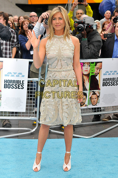 "Jennifer Aniston.""Horrible Bosses"" UK Premiere, BFI, London, England..20th July 2011.full length length white cream dress sheer gold folds folded pleats pleated sleeveless braid braided belt sequins sequined ribbon ankle shoes peep toe hand waving.CAP/CAS.©Bob Cass/Capital Pictures."