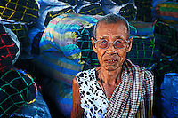 This old lady is selling whole sale Charcoal in Battambang, Cambodia