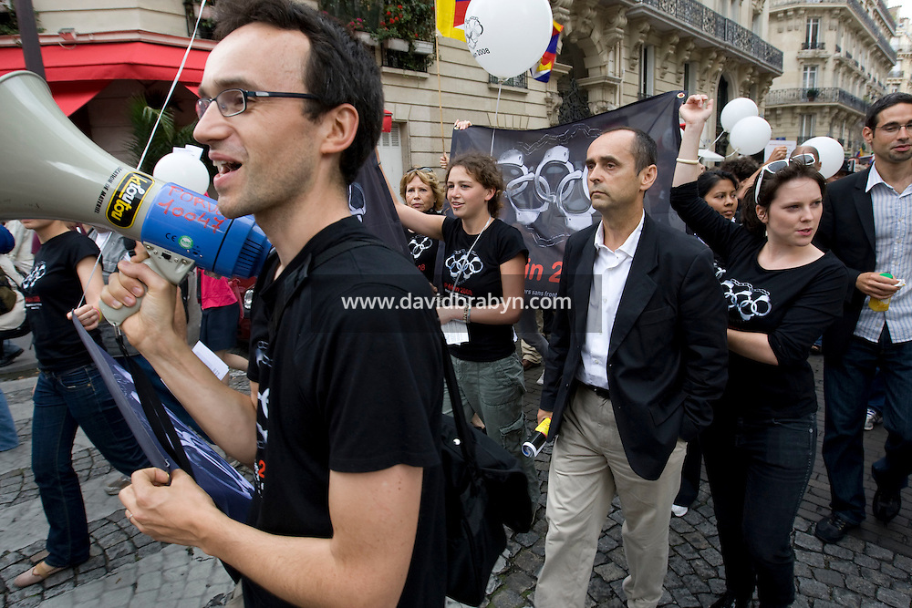 Reporters Sans Frontieres Secretary General, Robert Menard (4R, white shirt), preceded by Asia desk head Vincent Brossel (L), takes part in a street protest called by the press watchdog organisation against China's human rights policy, close to the Chinese embassy in Paris, France, on the day of the opening ceremony of the 2008 Olympic Games in Beijing, 8 August 2008.