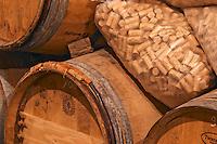 Barrels and bags of corks in the wine cellar - Chateau Haut Bergeron, Sauternes, Bordeaux