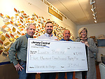 Jersey Central Power & Light Employees John Mahon (L), Kieran Tintle (2nd L) and William Puchik (2nd R) present a check for $5,935.00 to Lunch Break Director of Development Kate McMahon (R) at the Lunch Break Facility in Red Bank, NJ on April 13, 2017.