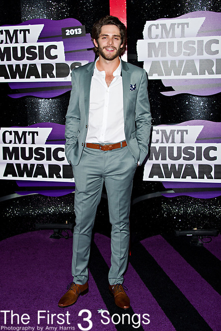 Thomas Rhett arrives at the 2013 CMT Music Awards at Bridgestone Arena in Nashville, Tennessee.