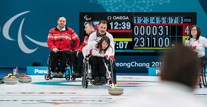 PyeongChang 14/3/2018 - Third Ina Forrest sends a rock as Canada takes on Slovakia in wheelchair curling at the Gangneung Curling Centre during the 2018 Winter Paralympic Games in Pyeongchang, Korea. Photo: Dave Holland/Canadian Paralympic Committee