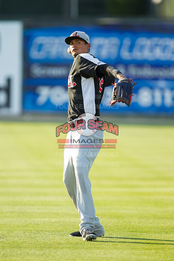 Jairo Beras (32) of the Hickory Crawdads warms up in the outfield prior to the game against the Kannapolis Intimidators at CMC-Northeast Stadium on May 5, 2014 in Kannapolis, North Carolina.  The Intimidators defeated the Crawdads 5-2.  (Brian Westerholt/Four Seam Images)