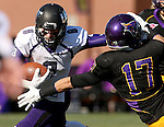MANKATO, MN - NOVEMBER 1:  Josh Angulo #8 for the University of Sioux Falls tries to shake the grasp of Justin Otto #17 from Minnesota State Mankato in the first quarter Saturday afternoon at Blakeslee Stadium in Mankato. (Photo by Dave Eggen/Inertia)
