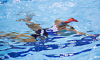 26 JUL 2012 - LONDON, GBR - Great Britain synchronised swimmer Jenna Randall (GBR) practices a section of her duet routine in the pool at the Aquatics Centre in the Olympic Park, Stratford, London, Great Britain ahead of the start of the London 2012 Olympic Games (PHOTO (C) 2012 NIGEL FARROW)