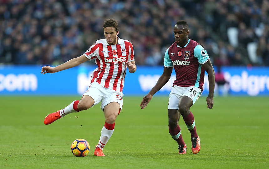 Stoke City's Ramadan Sobhi and West Ham United's Michail Antonio<br /> <br /> Photographer Rob Newell/CameraSport<br /> <br /> The Premier League - West Ham United v Stoke City - Saturday 5th November 2016 - The London Stadium - London<br /> <br /> World Copyright &copy; 2016 CameraSport. All rights reserved. 43 Linden Ave. Countesthorpe. Leicester. England. LE8 5PG - Tel: +44 (0) 116 277 4147 - admin@camerasport.com - www.camerasport.com