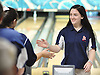 Julie Sandkuhl of St. John the Baptist gets congratulated after rolling a strike in the CHSAA girls' bowling championship against St. Dominic at Farmingdale Lanes on Thursday, Feb. 4, 2016.
