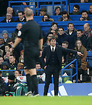 Chelsea's Antonio Conte watches referee Robert Madley during the Premier League match at Stamford Bridge Stadium, London. Picture date December 31st, 2016 Pic David Klein/Sportimage
