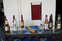 Empty Mexican beer bottles on a table outside a restaurant in Merida, Yucatan, Mexico...