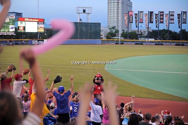 The Wingnuts baseball team's mascot entertains the crowd of spectators during a break in play in Wichita, Kansas on June 6, 2009.
