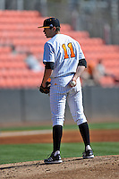 Tennessee Volunteers starting pitcher Kyle Serrano #11 looks in for the signals during a game against the UNLV Runnin' Rebels at Lindsey Nelson Stadium on February 22, 2014 in Knoxville, Tennessee. The Volunteers defeated the Rebels 5-4. (Tony Farlow/Four Seam Images)