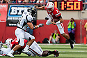 03 Sep 2011: Taylor Martinez #3 of the Nebraska Cornhuskers flies through the air trying to avoid being tackled in the first quarter against Chattanooga Mocs at Memorial Stadium in Lincoln, Nebraska. Nebraska defeated Chattanooga 40 to 7.