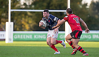 David Cherry of London Scottish in action under pressure from Nick Selway of Jersey during the Greene King IPA Championship match between London Scottish Football Club and Jersey at Richmond Athletic Ground, Richmond, United Kingdom on 7 November 2015. Photo by Andy Rowland.