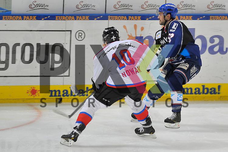 Mannheims Dominik Bittner (Nr.52) gegen Nuernbergs Marco Nowak (Nr.10)  beim Spiel in der DEL, Adler Mannheim - Nuernberg Ice Tigers.<br /> <br /> Foto &copy; Ice-Hockey-Picture-24 *** Foto ist honorarpflichtig! *** Auf Anfrage in hoeherer Qualitaet/Aufloesung. Belegexemplar erbeten. Veroeffentlichung ausschliesslich fuer journalistisch-publizistische Zwecke. For editorial use only.