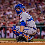 28 April 2017: New York Mets catcher Travis d'Arnaud glances back to the dugout during a game against the Washington Nationals at Nationals Park in Washington, DC. The Mets defeated the Nationals 7-5 to take the first game of their 3-game weekend series. Mandatory Credit: Ed Wolfstein Photo *** RAW (NEF) Image File Available ***