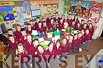 Pupils from Knockaclarig National School prepare for their first green flag with a school project based on recycling, pictured here last Friday with their entry. .