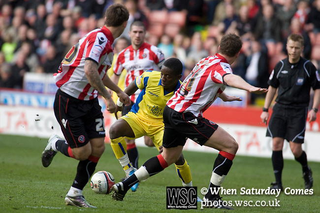 Sheffield United 2 Leeds United 0, 19/03/2011. Bramall Lane, Championship. Leeds United Max Gradel taking on the Sheffield United defence at  Bramall Lane during the first half of the Npower Championship fixture against Sheffield United. The home team won the game by two goals to nil watched by a crowd of 23,728. Bramall Lane is the world's oldest professional football ground and at one time hosted both football and cricket. Photo by Colin McPherson.