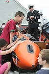 Stabannon Primary School pupils when members of the Coastguard visited their school to give them a talk on water safety...Photo NEWSFILE/Jenny Matthews.(Photo credit should read Jenny Matthews/NEWSFILE)....This Picture has been sent you under the condtions enclosed by:.Newsfile Ltd..The Studio,.Millmount Abbey,.Drogheda,.Co Meath..Ireland..Tel: +353(0)41-9871240.Fax: +353(0)41-9871260.GSM: +353(0)86-2500958.email: pictures@newsfile.ie.www.newsfile.ie.FTP: 193.120.102.198.