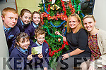 Launching the Killarney Memory tree of light in association with Kilcummin NS parents association were Saoirse Sweeney, Dara O'Shea, Amanda Murray, Mairead O'Sullivan. Back row: Evan O'sullivan, Katelyn O'Riordan and Rebecca O'Sullivan