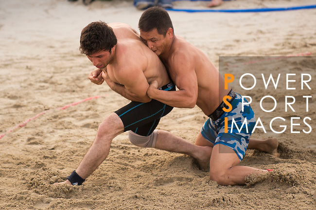 Wrestlers compete during the Beach Wrestling Men's competition between Mongolia and Afghanistan on Day Eight of the 5th Asian Beach Games 2016 at Bien Dong Park on 01 October 2016, in Danang, Vietnam. Photo by Marcio Machado / Power Sport Images