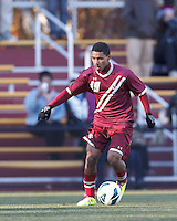 Boston College forward/midfielder Zeiko Lewis (19) brings the ball forward. Boston College (maroon) defeated Virginia Tech (Virginia Polytechnic Institute and State University) (white), 3-1, at Newton Campus Field, on November 3, 2013.
