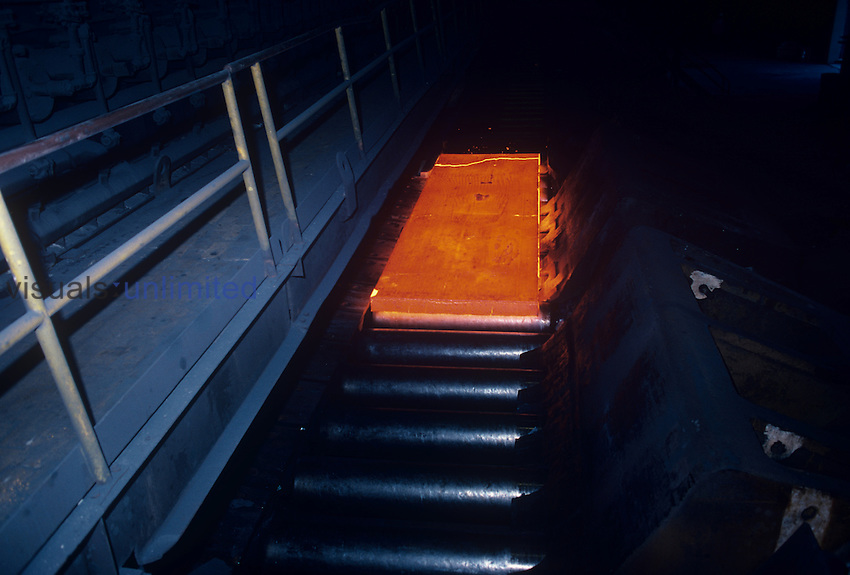A slab of molten steel in a steel mill.