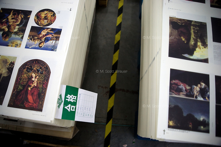 "Pages of newly-printed Biblical imagery sit on palettes in the Amity Printing Company's new printing facility in Nanjing, China....On May 18, 2008, the Amity Printing Company in Nanjing, Jiangsu Province, China, inaugurated its new printing facility in southern Nanjing.  The facility doubles the printing capacity of the company, now up to 12 million Bibles produced in a year, making Amity Printing Company the largest producer of Bibles in the world.  The company, in cooperation with the international organization the United Bible Societies, produces Bibles for both domestic Chinese use and international distribution.  The company's Bibles are printed in Chinese and many other languages.  Within China, the Bibles are distributed both to registered and unregistered Christians who worship in illegal ""house churches."""