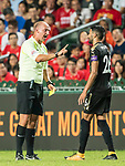 Referee Bobby Madley (L) shows Leicester City FC midfielder Riyad Mahrez the yellow card during the Premier League Asia Trophy match between Liverpool FC and Leicester City FC at Hong Kong Stadium on 22 July 2017, in Hong Kong, China. Photo by Weixiang Lim / Power Sport Images
