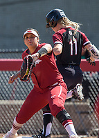 NWA Democrat-Gazette/BEN GOFF @NWABENGOFF<br /> Ashley Diaz, Arkansas first baseman, catches the ball as Haley Simpson, South Carolina right fielder, arrives safe at the bag in the 4th inning Sunday, March 17, 2019, at Bogle Park in Fayetteville.