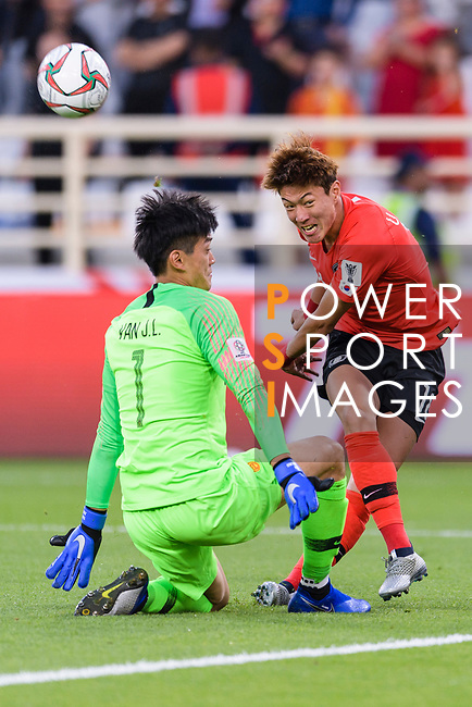 China Goalkeeper Yan Junling (L) block the attempt on goal of Hwang Uijo of South Korea (R) during the AFC Asian Cup UAE 2019 Group C match between South Korea (KOR) and China (CHN)  at Al Nahyan Stadium on 16 January 2019 in Abu Dhabi, United Arab Emirates. Photo by Marcio Rodrigo Machado / Power Sport Images