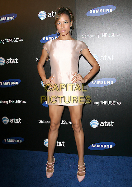 DANIA RAMIREZ.The Samsung Infuse 4G Launch Event  held at Milk Studios in Hollywood, California, USA..May 12th, 2011.full length hair up pink silk satin dress hands on hips shoes triple three 3 straps mary janes .CAP/RKE/DVS.©DVS/RockinExposures/Capital Pictures.