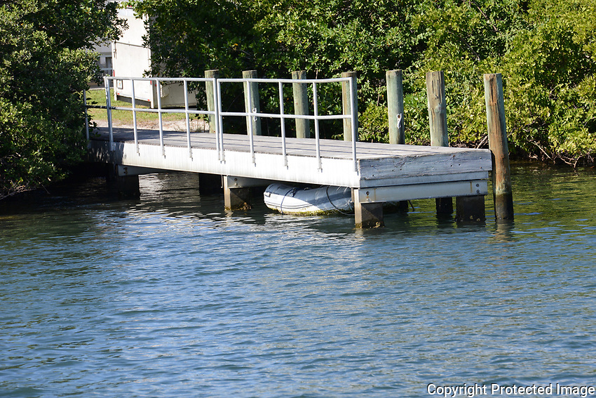 Lost rubber dinghy under dock located at Harvey Oyer  Intracoastal Park, Boynton Bech, Florida.