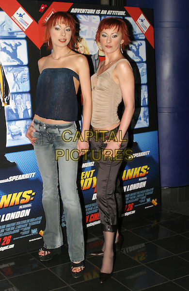 CHEEKY GIRLS.MONICA & GABRIELA IRIMIA.Agent Cody Banks 2 premiere.24 March 2004.full length, full-length, denim jeans, ruched top, cropped trousers, identical twins.www.capitalpictures.com.sales@capitalpictures.com.© Capital Pictures.