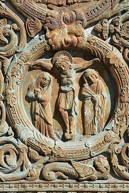 Bas relief of the crusifiction of Christ from the Gothic doors of the Cathedral Basilica of Saint Denis ( Basilique Saint-Denis ) Paris, France. A UNESCO World Heritage Site.