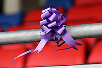 A purple ribbon in memory of Jodie Chesney during Dagenham & Redbridge vs Bromley, Vanarama National League Football at the Chigwell Construction Stadium on 9th March 2019