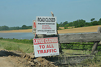 8/12/11} Vicksburg} -- Vicksburg, MS, U.S.A. --The entrance to the YAzoo backwater levee is closed to all traffic. Members of The Corp of Engineering and Col. Eckstein hold a press conference on the Yazoo backwater levee, detailing how they are trying to contain the flood water from the Mississippi River from flooding over 1.2 million acres of farm land and damaging thousands of homes and disrupting thousands of people. Vicksburg a riverfront town steeped in war and sacrifice, gets set to battle an age-old companion: the Mississippi River. The city that fell to Ulysses S. Grant and the Union Army after a painful siege in 1863 is marshalling a modern flood-control arsenal to keep the swollen Mississippi from overwhelming its defenses. PHOTO©SUZIALTMAN.COM.Photo by Suzi Altman, Freelance.