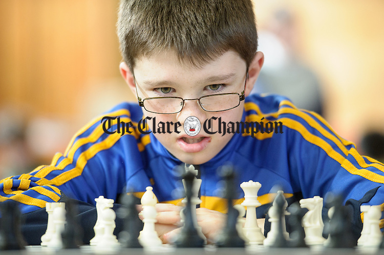 Ronan Kilroy of Ennis ponders on his next move at the Clare Community games chess county finals in St Flannan's college, Ennis. Photograph by John Kelly.