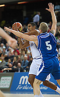 20 AUG 2014 - LONDON, GBR - Kieron Achara (GBR) (left) from Great Britain tries to avoid a challenge from Haukur Palsson (ISL) (right) from Iceland during their men's 2015 EuroBasket 3rd Qualifying Round game at the Copper Box Arena in the Queen Elizabeth Olympic Park in Stratford, London, Great Britain (PHOTO COPYRIGHT © 2014 NIGEL FARROW, ALL RIGHTS RESERVED)