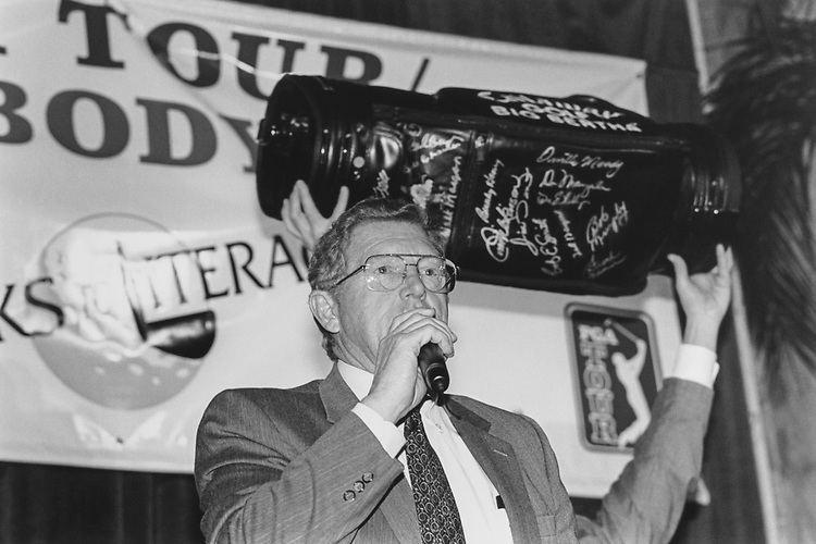 "Sen. Conrad Burns, R-Mont., official auctioneer, holds up leather golf bag with pro golfers signature at the Everybody Wins"" fundraiser at Union Station on Feb. 22, 1996. (Photo by Laura Patterson/CQ Roll Call via Getty Images)"