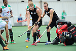 The Hague, Netherlands, June 03: Blair Tarrant #22 and Hugo Inglis #29 of New Zealand battle for the ball during the field hockey group match (Men - Group B) between South Africa and the Black Sticks of New Zealand on June 3, 2014 during the World Cup 2014 at GreenFields Stadium in The Hague, Netherlands. Final score 0:5 (0:3) (Photo by Dirk Markgraf / www.265-images.com) *** Local caption ***