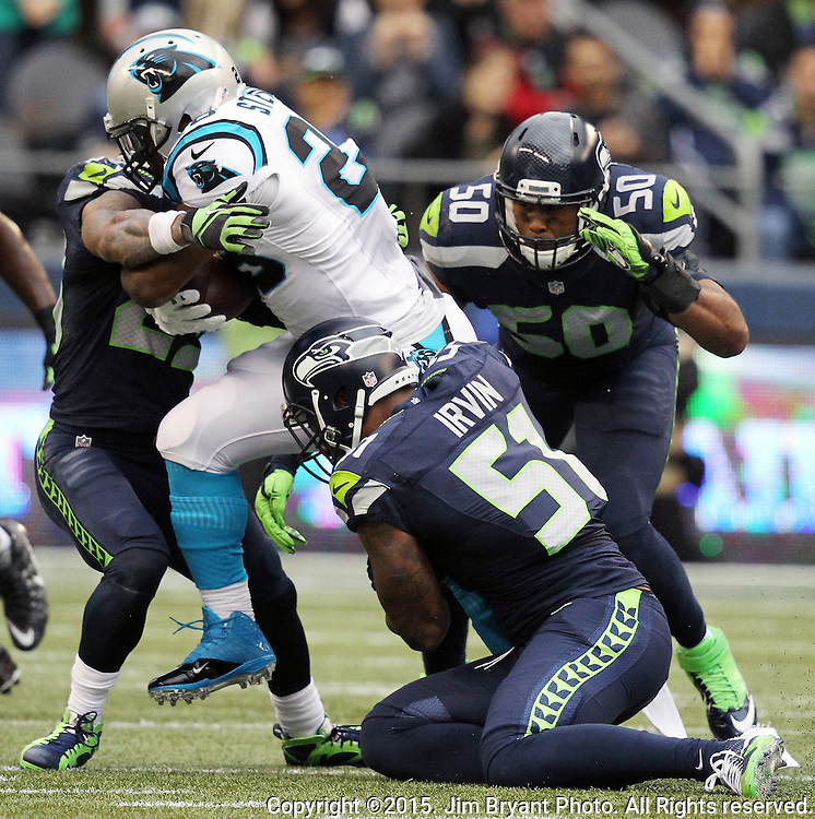 Seattle Seahawks  free safety Earl Thomas (29) and linebacker Bruce Irvin (51) and K.J. Wright (50) tackles Carolina Panthers  running back Jonathan Stewart (28) at CenturyLink Field in Seattle on October 18, 2015. The Panthers came from behind with 32 seconds remaining in the 4th Quarter to beat the Seahawks 27-23.  ©2015 Jim Bryant Photography. All Rights Reserved.