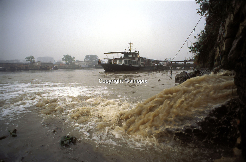 Polluted, untreated water is pumped from a drinks bottling plant directly into a tributary of the Pearl river outside Guangzhou, China..