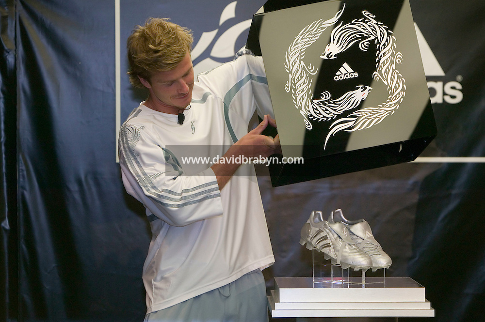 England captain, Real Madrid player and global soccer star David Beckham unveils the new Predator Adidas soccer boots for the media assembled in a Adidas store in New York, USA, 1 June 2005.<br />