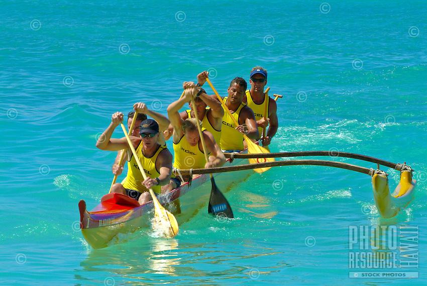 A lifeguard team paddles a Hawaiian outrigger canoe to the finish in a race during legendary surfer and waterman Duke Kahanamoku 's birthday celebration. Waikiki Beach.