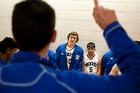 Grandview High School unified basketball players Taylor Schultz (cq, middle left) and Chuckie Moss (cq, middle left) listen to a pre-game pep talk before a game against Overland High School at Grandview High School in Aurora, Colorado, Wednesday, February 1, 2012. Unified sports teams, an outgrowth of the Special Olympics, are teams with both special needs and traditional high school students as players. The idea is that special needs kids shouldn't be separated and be allowed to participate in a competitive games as well at their schools...Photo by Matt Nager