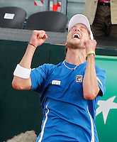 Italy's Andreas Seppi celebrates  after winning his   Davis Cup quarter-final tennis match against Britain's James Ward in Naples April 6, 2014.