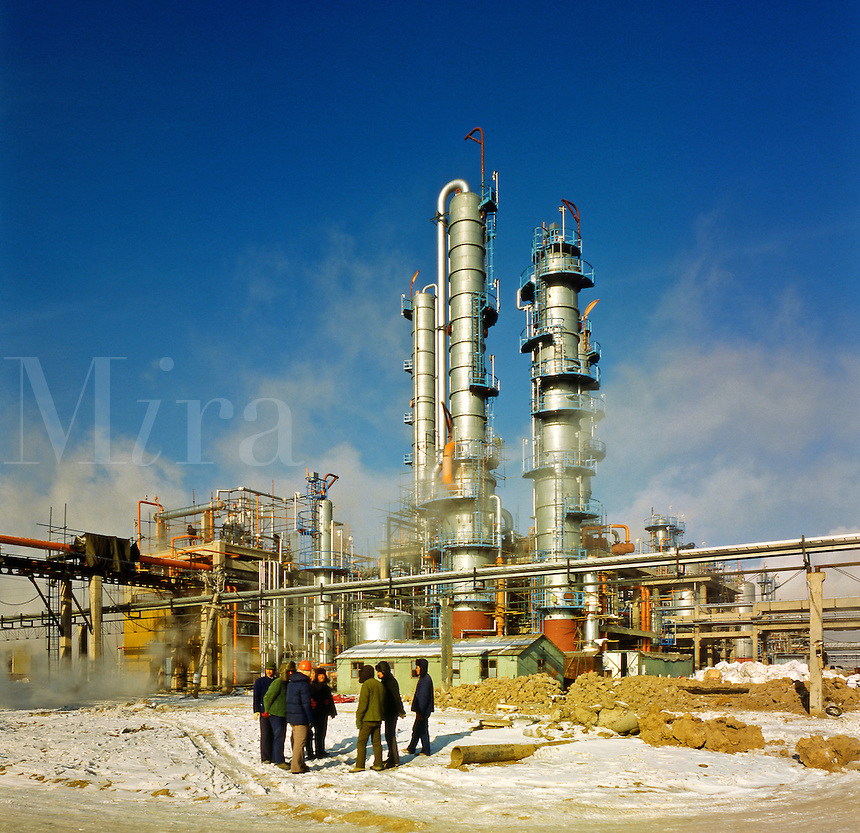 China, Manchuria.  Site managers meet in sub-zero temperatures during the construction of petrochemical plant at Daqing, site of China's largest oil field.  Oil refinery.