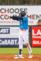 Wisconsin Timber Rattlers outfielder Je'Von Ward (4) celebrates at second base during a Midwest League game against the Lake County Captains on May 10, 2019 at Fox Cities Stadium in Appleton, Wisconsin. Wisconsin defeated Lake County 5-4. (Brad Krause/Four Seam Images)